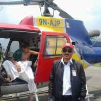 Captain with Helicopter at Pokhara Airport