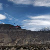 Helicopter flying above Jomsom Village