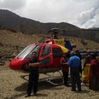 Helicopter at Muktinath Helipad with snow