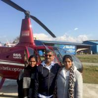 Clients at Pokhara airport infront of helicopter