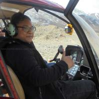 Pilot inside helicopter at Muktinath