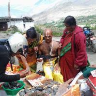 Buying shaligram at Muktinath